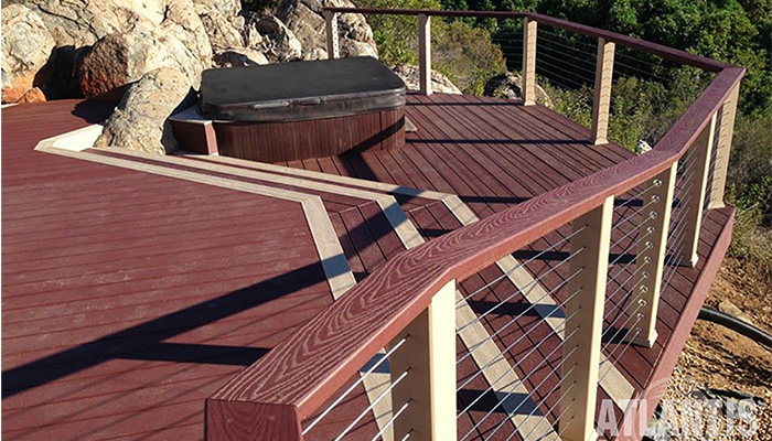 Cable Railing System around a deck with hot tub.