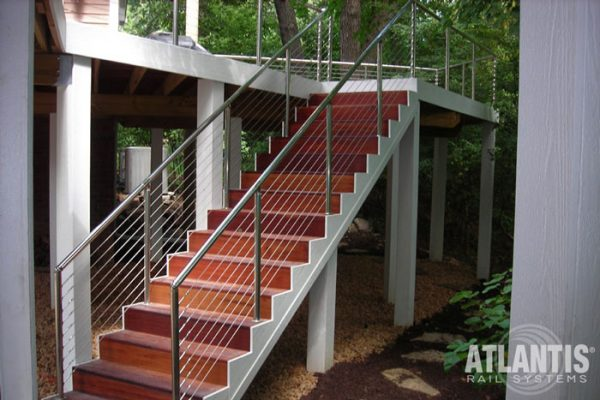 Cable railing on an outdoor staircase.