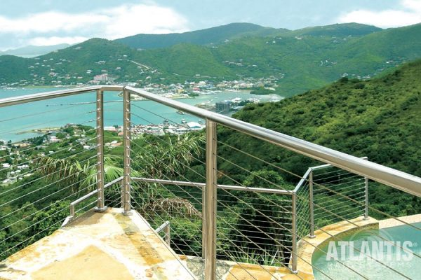 Cable railing on deck overlooking the Carribean.