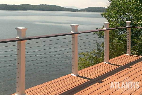 Top rail on cable railing on a lakefront deck.
