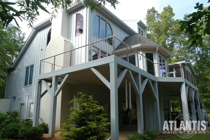 Home with stainless steel for cable railing on the 2nd story deck.