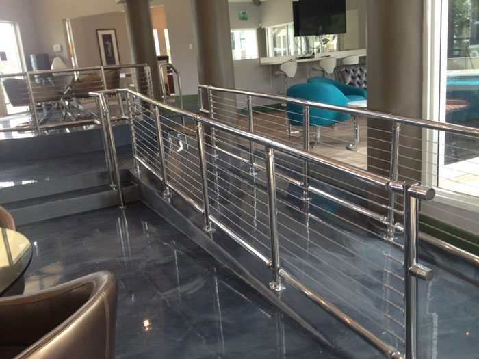 Cable railing on indoor home ramp.