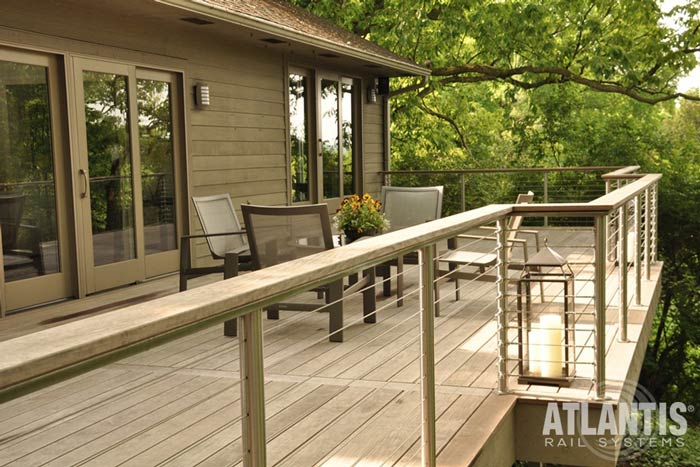 Cleaning-and-maintaining-stainless-steel-cable-railings-with wooden elements.