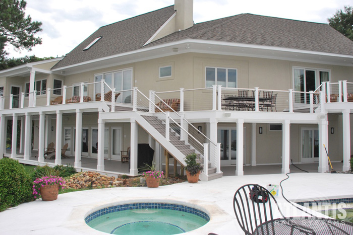 Cable railing on a large home deck patio.