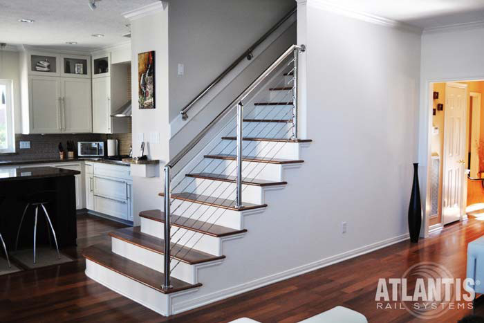 Cable railing system on interior stairs with proper tension for safety and durability.